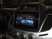Фотография установки магнитолы Alpine INE-W990BT в Mitsubishi Pajero Sport